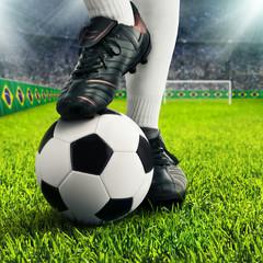 Füße eines Fußballers im Stadion