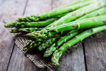 Bunch of fresh green asparagus on wooden rustic table