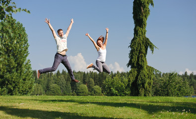 Young couple jumping outside