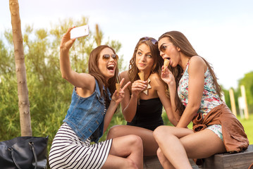 3 beautiful girlfriend eating ice cream while Selfie photo