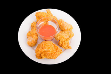 Fried Chicken with Hot Sauce on Black Background