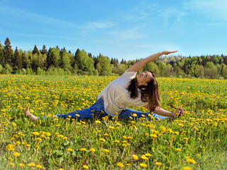 Girl engaged in yoga in the morning, in nature