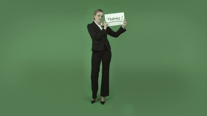 attractive caucasian business girl isolated on green grateful