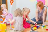 Kids playing in kindergarten.