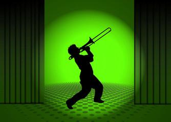 Tocando el trombón, músico, escenario, luz verde