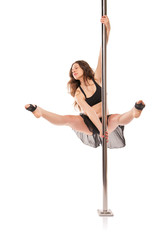 Young sexy woman exercise pole dance against white