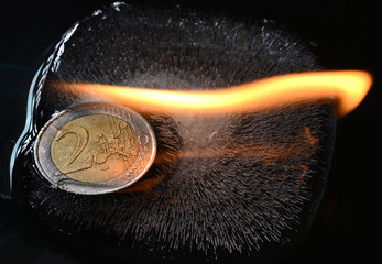 Euro in ice on fire