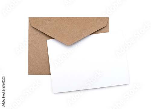 brown envelope with a blank white card over white - 65662203