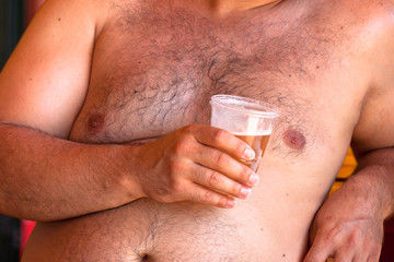 Obese man with beer