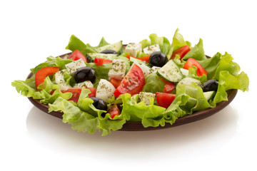 salad in plate on white