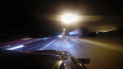 Fast moving car on the night road timelapse footage