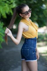 Trendy long haired girl posing