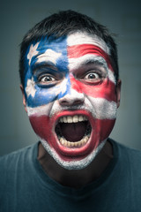 Angry man with USA flag painted on face