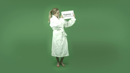 attractive caucasian girl in bathrobe isolated on green grateful