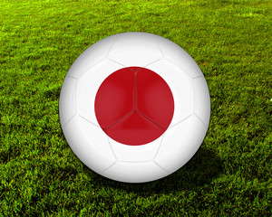 3d Japan Soccer Ball with Grass Background - isolated