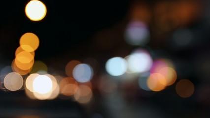 Defocused night traffic lights in Bangkok, Thailand