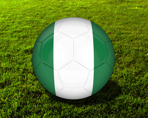 3d Nigeria Soccer Ball with Grass Background - isolated