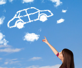 Young girl looking at car cloud on a blue sky