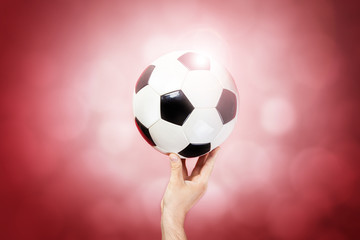 Hand hold ball on color background