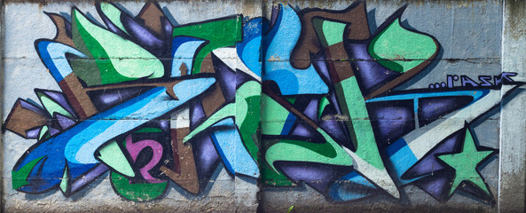 Colorful graffity on the wall in the centre of the town