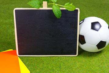 Anzeigetafel mit Fußball