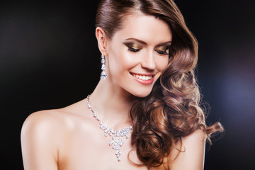 close up beauty portrait of happy brunette woman with luxury
