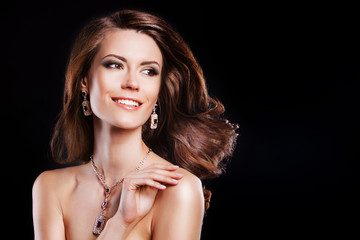 beautiful smiling brunette woman with luxury accessories. windy