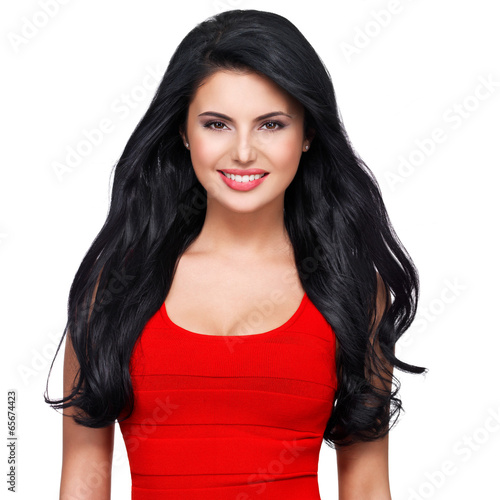 Portrait  of  young smiling woman with long brown hair.