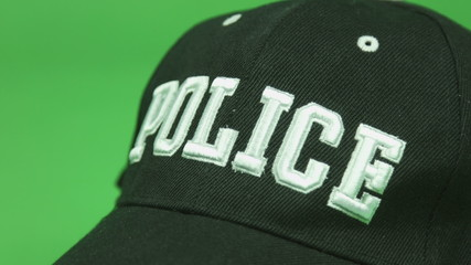 police cap isolated on chroma green screen background