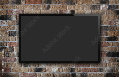 canvas print picture TV display on brick wall