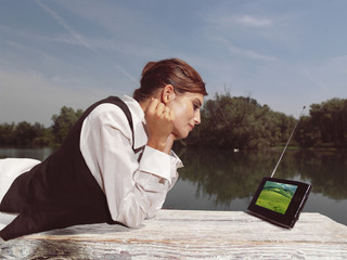 a woman with laptop in park
