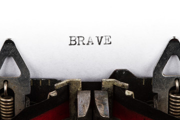 Typewriter with text brave