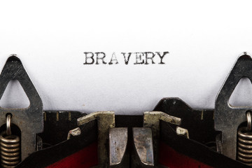 Typewriter with text bravery