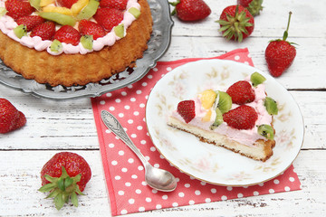 homemade cake with strawberry and whipped cream