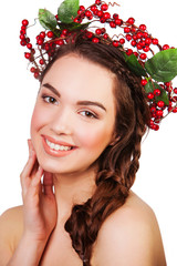 beautiful girl with a wreath of berries. woman smiling face