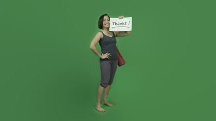 caucasian sporty girl with yoga mat isolated on green screen
