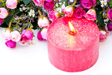 Pink candle and flowers