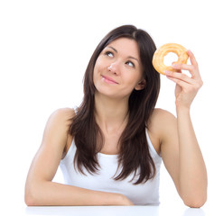 Woman enjoy sweet donut junk food weight loss concept