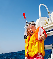 Happy child on yacht.