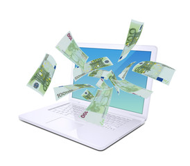 Euro notes flying around the laptop