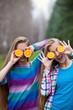 Девушки с апельсинами на природе