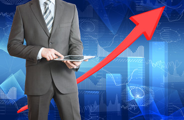 Businessman hold tablet and red arrow