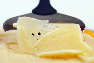 Closeup of cheese with slicer , shallow dof