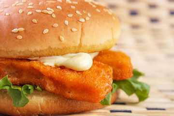 Fish stick burger with mayonnaise closeup