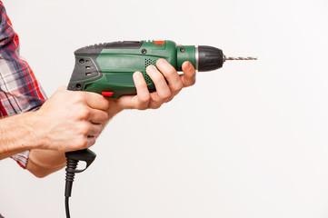 Man using drill.
