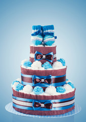 cake made from diapers on blue background