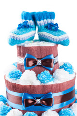 cake made from diapers on white background