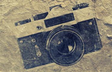 Retro camera on paper background