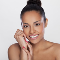 Portrait of a beautiful African woman smiling.Beauty shot