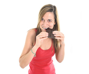 Woman eating big chocolate bar forgetting about diet